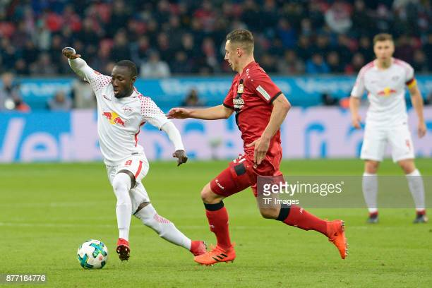 Naby Keita of Leipzig and Dominik Kohr of Leverkusen battle for the ball during the Bundesliga match between Bayer 04 Leverkusen and RB Leipzig at...