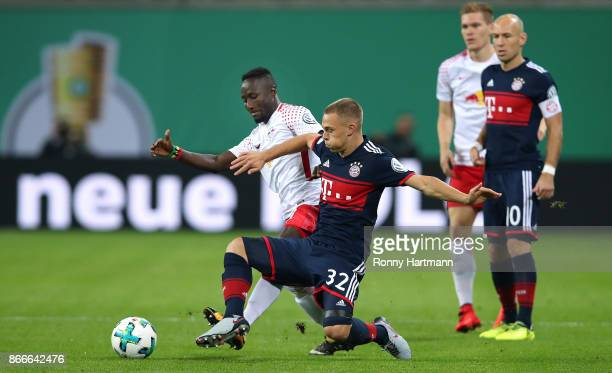 Naby Keita of Leipzig and Joshua Kimmich of Muenchen vie during the DFB Cup round 2 match between RB Leipzig and Bayern Muenchen at Red Bull Arena on...