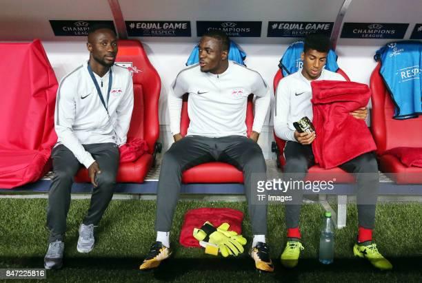 Naby Keita of Leipzig and Yvon Lar Mvogo Nganoma of Lepzig and Bernardo Fernandes da Silva of Leipzig sits on the bench during the UEFA Champions...