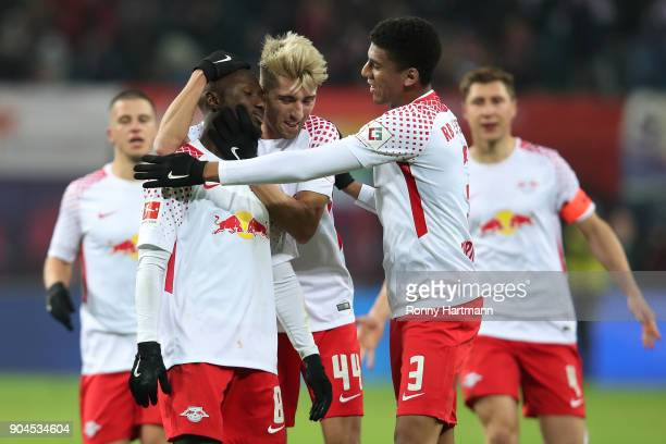 Naby Keita of Leipzig celebrates after he scored a goal to make it 10 with Kevin Kampl of Leipzig and Bernardo of Leipzig during the Bundesliga match...
