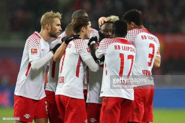 Naby Keita of Leipzig celebrates with his team after he scored a goal to make it 10 during the Bundesliga match between RB Leipzig and FC Schalke 04...