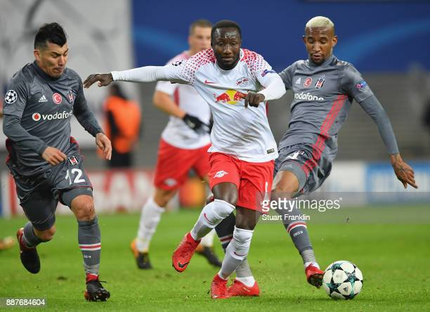 Naby Keita of Leipzig is challenged by Gary Medel and Anderson Talisca of Besiktas during the UEFA Champions League group G match between RB Leipzig...