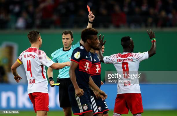 Naby Keita of Leipzig is sent off by referee Felix Zwayer during the DFB Cup match between RB Leipzig and Bayern Muenchen at Red Bull Arena on...