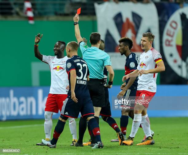 Naby Keita of Leipzig is sent off by referee Felix Zwayer during the DFB Pokal soccer match between RB Leipzig and Bayern Muenchen at the Red Bull...