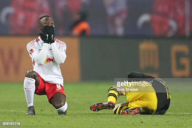 Naby Keita of Leipzig looks surprised after a foul on Julian Weigl of Dortmund during the Bundesliga match between RB Leipzig and Borussia Dortmund...