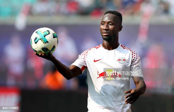 Naby Keita of Leipzig passes the ball during the Bundesliga match between RB Leipzig and SportClub Freiburg at Red Bull Arena on August 27 2017 in...