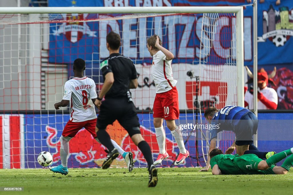 Naby Keita (L) of Leipzig scores his team's fourth during the Bundesliga match between RB Leipzig and SV Darmstadt 98 at Red Bull Arena on April 1, 2017 in Leipzig, Germany.