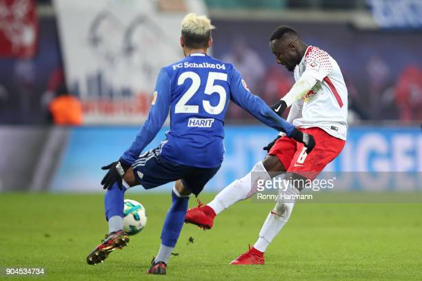 Naby Keita of Leipzig shoots on target and scores a goal to make it 10 during the Bundesliga match between RB Leipzig and FC Schalke 04 at Red Bull...