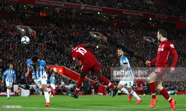 Naby Keita of Liverpool and Juninho Bacuna of Huddersfield Town in action during the Premier League match between Liverpool FC and Huddersfield Town...