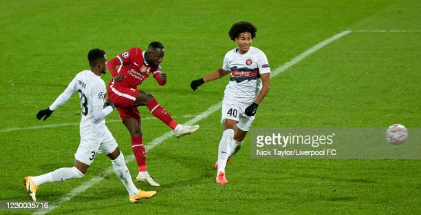 Naby Keita of Liverpool and Luca Pfeiffer and Jens-Lys Cajuste of Midtjylland in action during the UEFA Champions League Group D stage match between...