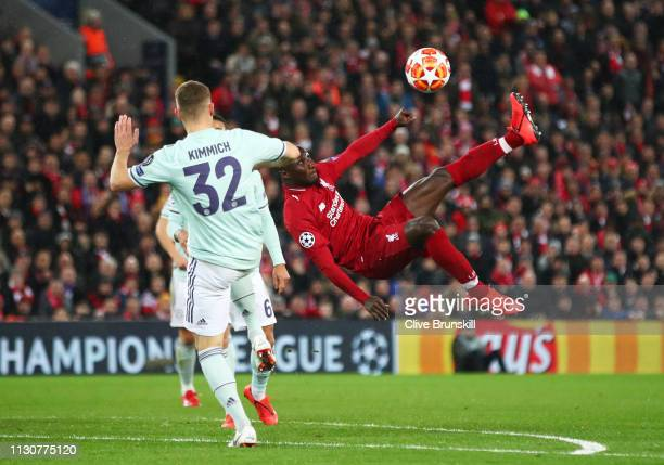 Naby Keita of Liverpool ateempts a spectacular shot goalwards as Joshua Kimmich of Bayern Munich challenges during the UEFA Champions League Round of...