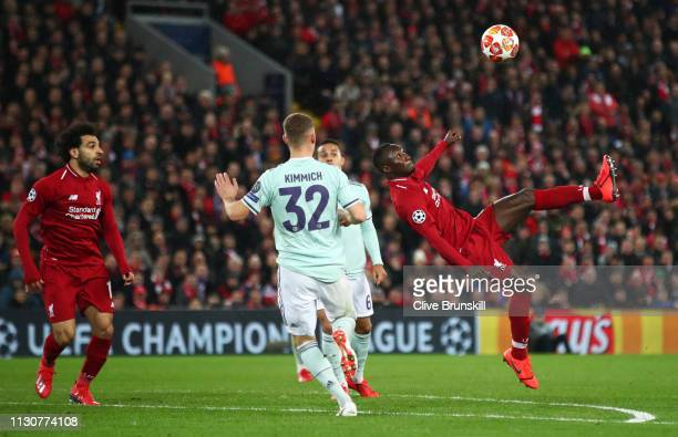 Naby Keita of Liverpool ateempts a spectacular shot goalwards during the UEFA Champions League Round of 16 First Leg match between Liverpool and FC...