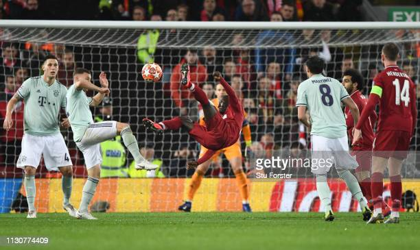 Naby Keita of Liverpool attempts a spectacular shot goalwards during the UEFA Champions League Round of 16 First Leg match between Liverpool and FC...