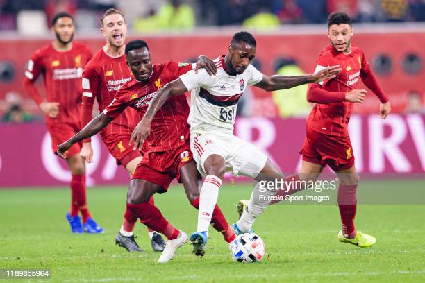 Naby Keita of Liverpool battles for the ball with Gerson da Silva of Flamengo during the FIFA Club World Cup Final match between Liverpool FC and CR...