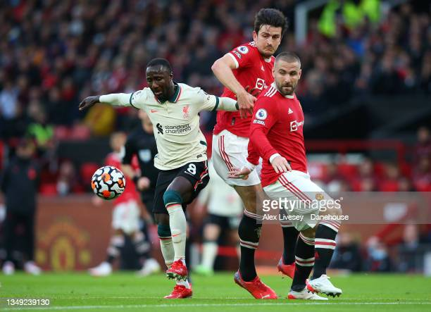 Naby Keita of Liverpool beats Harry Maguire and Luke Shaw of Manchester United during the Premier League match between Manchester United and...