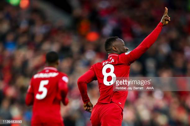 Naby Keita of Liverpool celebrates after scoring a goal to make it 10 during the Premier League match between Liverpool FC and Huddersfield Town at...