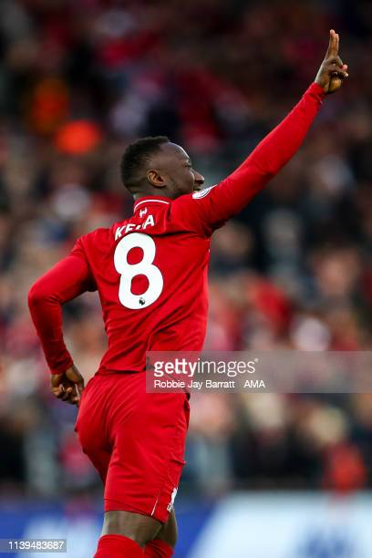 Naby Keita of Liverpool celebrates after scoring a goal to make it 1-0 during the Premier League match between Liverpool FC and Huddersfield Town at...