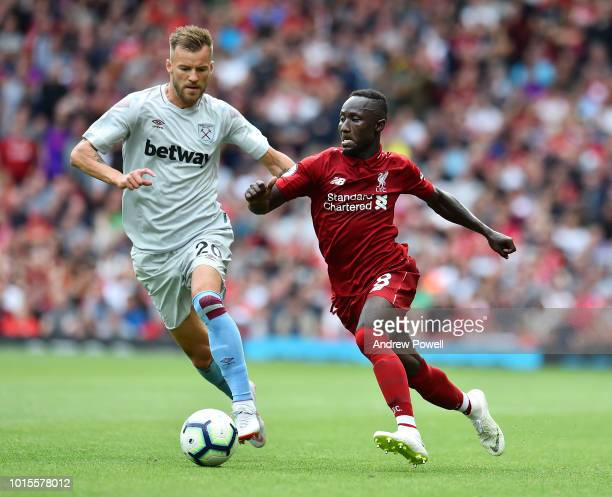 Naby Keita of Liverpool celebrates after scoring during the Premier League match between Liverpool FC and West Ham United at Anfield on August 12...