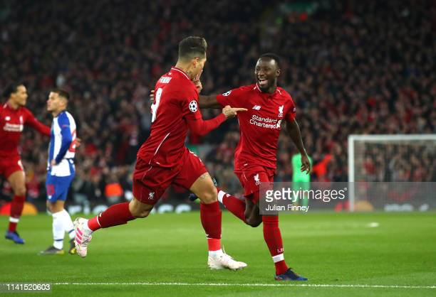 Naby Keita of Liverpool celebrates after scoring his team's first goal with Roberto Firmino of Liverpool during the UEFA Champions League Quarter...