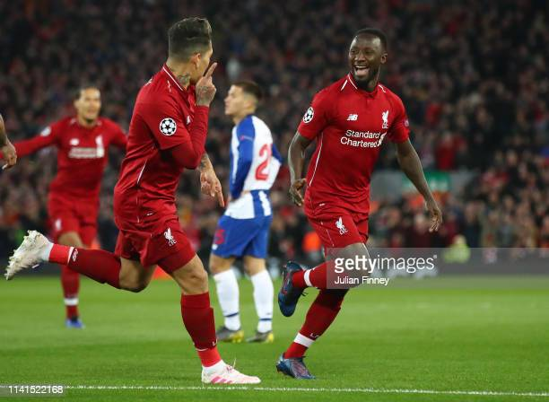 Naby Keita of Liverpool celebrates after scoring his team's first goal with teammate Roberto Firmino during the UEFA Champions League Quarter Final...