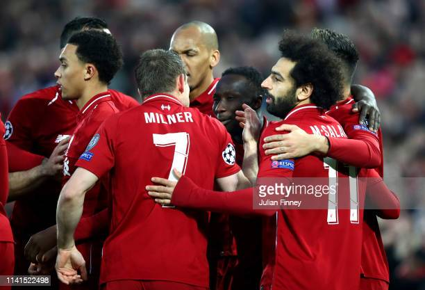 Naby Keita of Liverpool celebrates after scoring his team's first goal with his team mates during the UEFA Champions League Quarter Final first leg...