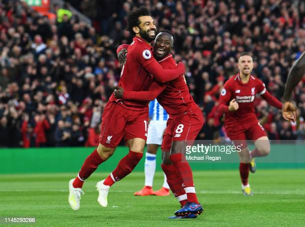 Naby Keita of Liverpool celebrates after scoring his team's first goal with Mohamed Salah during the Premier League match between Liverpool FC and...