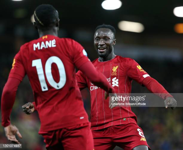 Naby Keita of Liverpool celebrates the only goal of the match with goalscorer Sadio Mane during the Premier League match between Norwich City and...