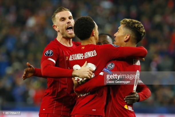 Naby Keita of Liverpool celebrates with his teammates after scoring the opening goal during the UEFA Champions League Group E match between FC Red...