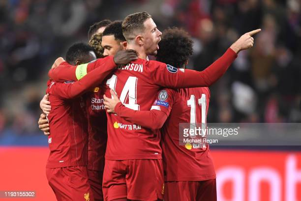 Naby Keita of Liverpool celebrates with Jordan Henderson and team mates after he scores his team's first goal during the UEFA Champions League group...