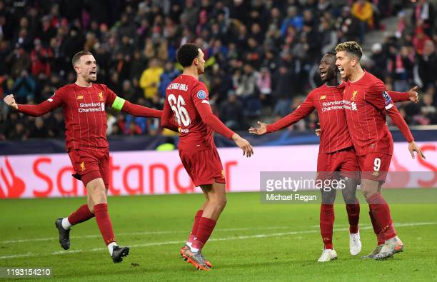 Naby Keita of Liverpool celebrates with Roberto Firmino after he scores his team's first goal during the UEFA Champions League group E match between...