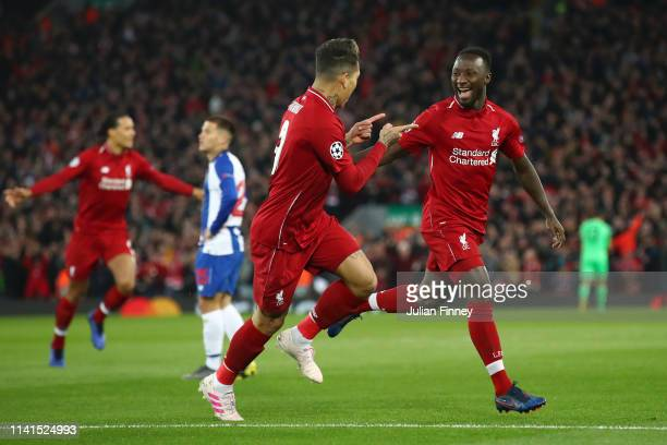 Naby Keita of Liverpool celebrates with teammate Roberto Firmino of Liverpafter scoring his team's first goal with Roberto Firmino of Liverpool...