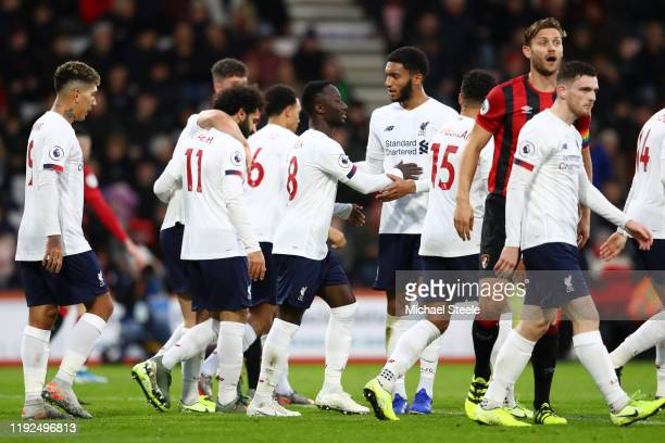 Naby Keita of Liverpool celebrates with teammates after scoring his team's second goal during the Premier League match between AFC Bournemouth and...