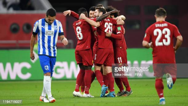 Naby Keita of Liverpool celebrates with teammates after scoring their team's first goal during the FIFA Club World Cup semi-final match between...