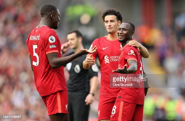 Naby Keita of Liverpool celebrates with teammates Curtis Jones and Ibrahima Konate after scoring their team's third goal during the Premier League...