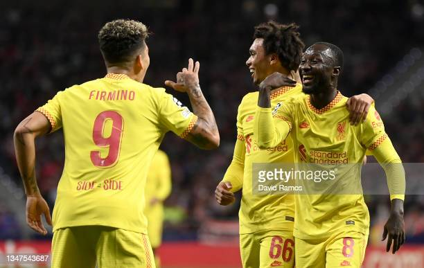 Naby Keita of Liverpool celebrates with Trent Alexander-Arnold and Roberto Firmino after scoring their side's second goal during the UEFA Champions...