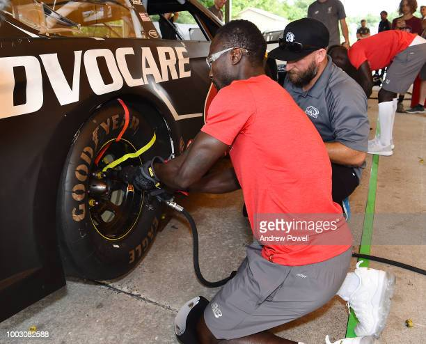 Naby Keita of Liverpool changing tyres during a tour of Roush Fenway Racing on July 21 2018 in Charlotte North Carolina