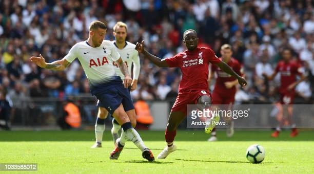 Naby Keita of Liverpool competes with Toby Alderweireld of Tottenham Hotspur the Premier League match between Tottenham Hotspur and Liverpool FC at...
