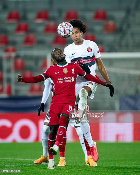 Naby Keita of Liverpool FC and Jens-Lys Cajuste of FC Midtjylland compete for the ball during the UEFA Champions League group play match between FC...