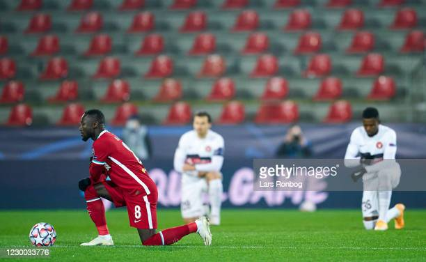 Naby Keita of Liverpool FC kneels for Black Lives Matter prior to the UEFA Champions League group play match between FC Midtjylland and Liverpool FC...