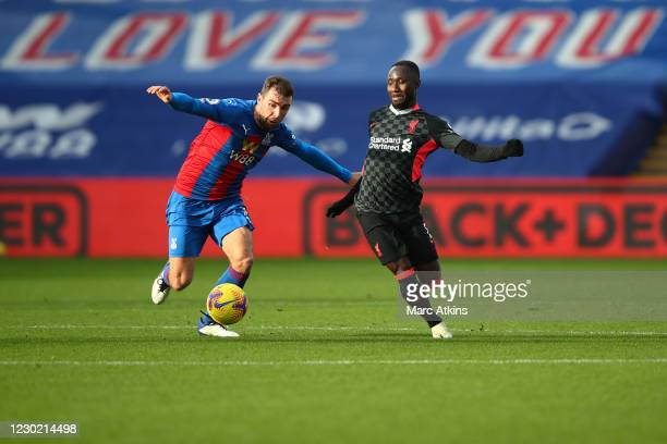 Naby Keita of Liverpool in action with James McArthur of Crystal Palace during the Premier League match between Crystal Palace and Liverpool at...