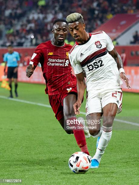 Naby Keita of Liverpool is challenged by Bruno Henrique of CR Flamengo during the FIFA Club World Cup Qatar 2019 Final match between Liverpool FC and...