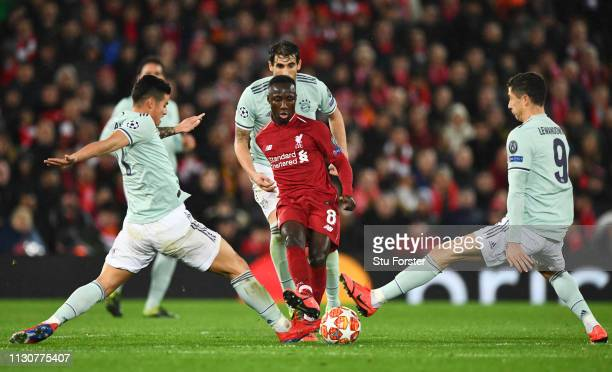 Naby Keita of Liverpool is challenged by James Rodriguez and Robert Lewandowski of Bayern Munich during the UEFA Champions League Round of 16 First...