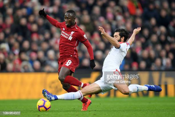 Naby Keita of Liverpool is challenged by James Tomkins of Crystal Palace during the Premier League match between Liverpool FC and Crystal Palace at...