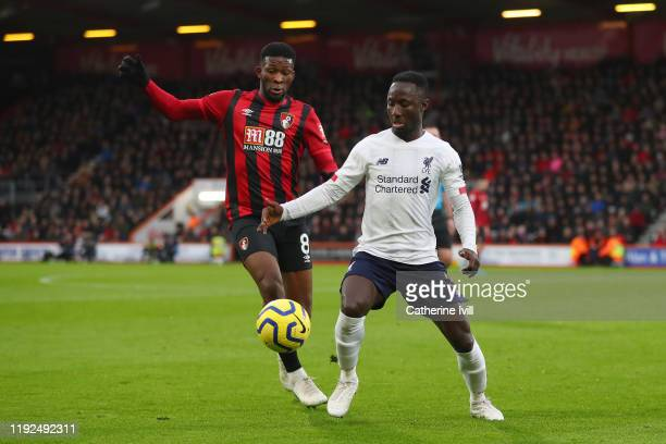 Naby Keita of Liverpool is challenged by Jefferson Lerma of AFC Bournemouth during the Premier League match between AFC Bournemouth and Liverpool FC...