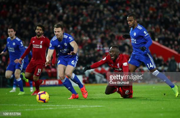 Naby Keita of Liverpool is challenged by Ricardo Pereira of Leicester City in the penalty area during the Premier League match between Liverpool FC...