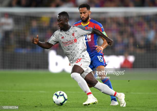 Naby Keita of Liverpool is closed down by Andros Townsend of Crystal Palace during the Premier League match between Crystal Palace and Liverpool FC...