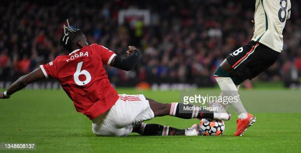 Naby Keita of Liverpool is fouled by Paul Pogba of Manchester United leading to a red card being shown following a VAR review during the Premier...