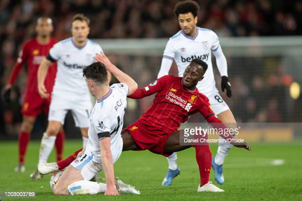 Naby Keita of Liverpool is tackled by Declan Rice of West Ham United during the Premier League match between Liverpool FC and West Ham United at...
