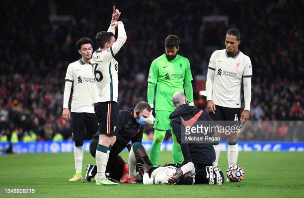 Naby Keita of Liverpool receives medical treatment following a challenge by Paul Pogba of Manchester United before being stretchered off during the...