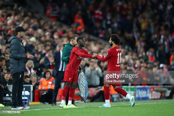 Naby Keita of Liverpool replaces Mohamed Salah during the UEFA Champions League group E match between Liverpool FC and RB Salzburg at Anfield on...